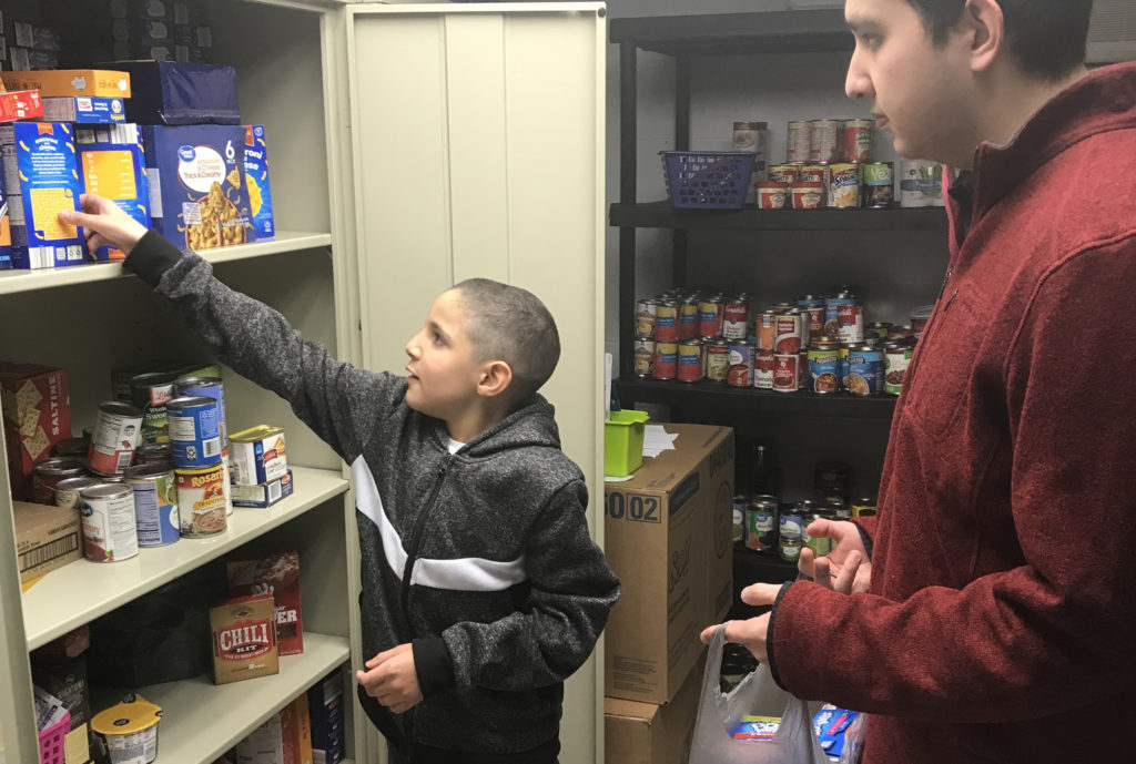 Roark helping a student at an In-School Pantry